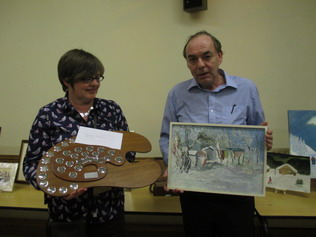 John Burton being presented with the winner's prize by Teresa Gabriel
